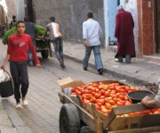 Vendors pushing carts of fresh tomatoes and cilantro to the Souk in Casablanca.