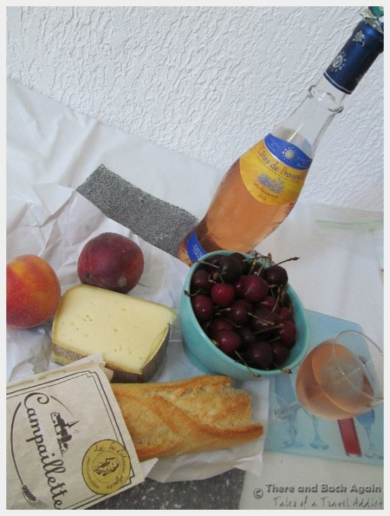 A baguette, fruit, bottle of wine and cheese from the Cours Saleya Market in nice France makes a budget friendly lunch.