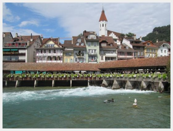 The adorable little town of Thun Switzerland and one of its covered bridges.