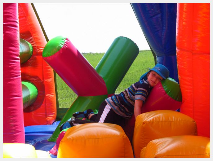 The kiddo in the ninja style obstacle course at the World's Largest Bounce House