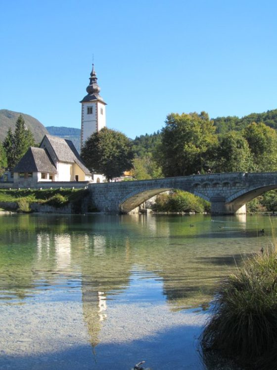 The oft photographed church and bridge in Ribcev Laz, on the banks of Lake Bohinj Slovenia.