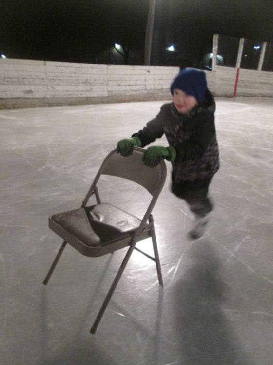 Son ice skating