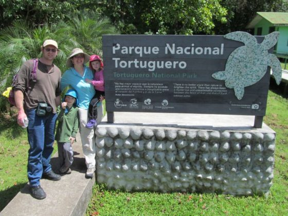 Family Picture next to Tortuguero National Park Sign