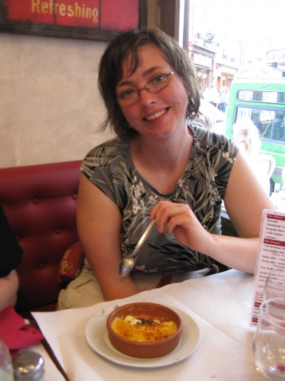 Shanna eating Creme Brulee when we splurged for a nice meal in a french cafe. Eating cheaply in paris is only worth it if you make sure to splurge at least once!