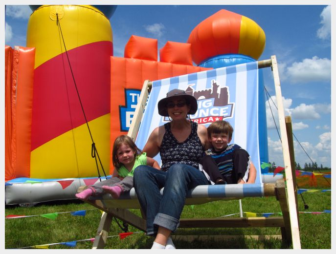 Both kiddos and I in front of the World's Largest Bounce House