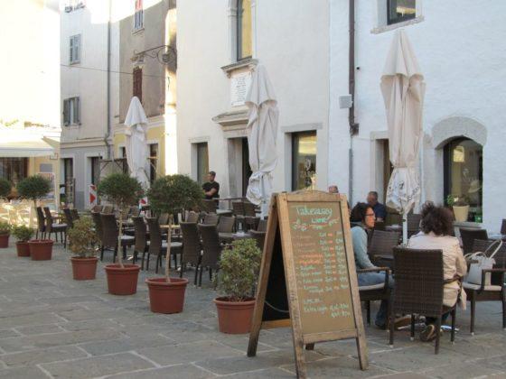 The Manzioli Wine Bar n a quiet square off of the harbor in Izola, Slovenia