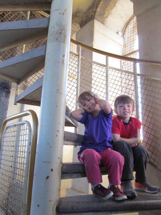 The kids climbing up the Koper Bell Tower.