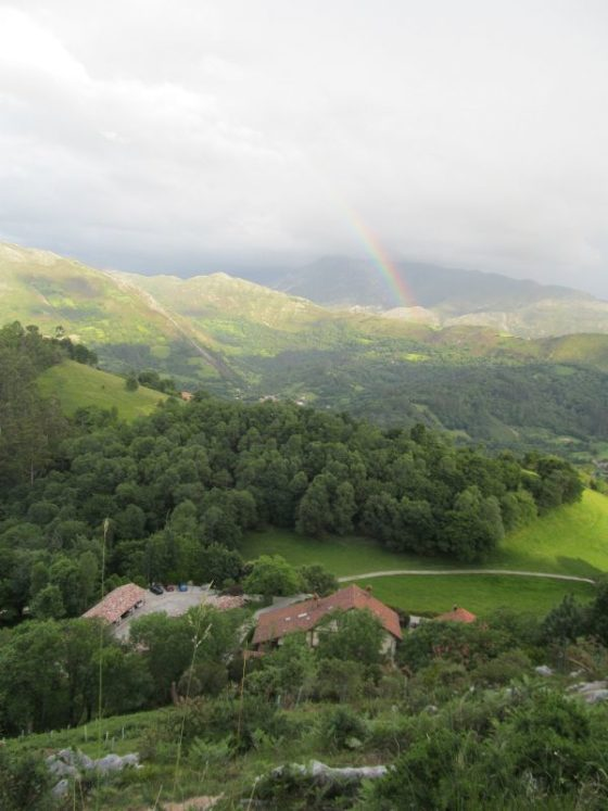 A beautiful overhead view of the farm with an amazing rainbow after a rainstorm
